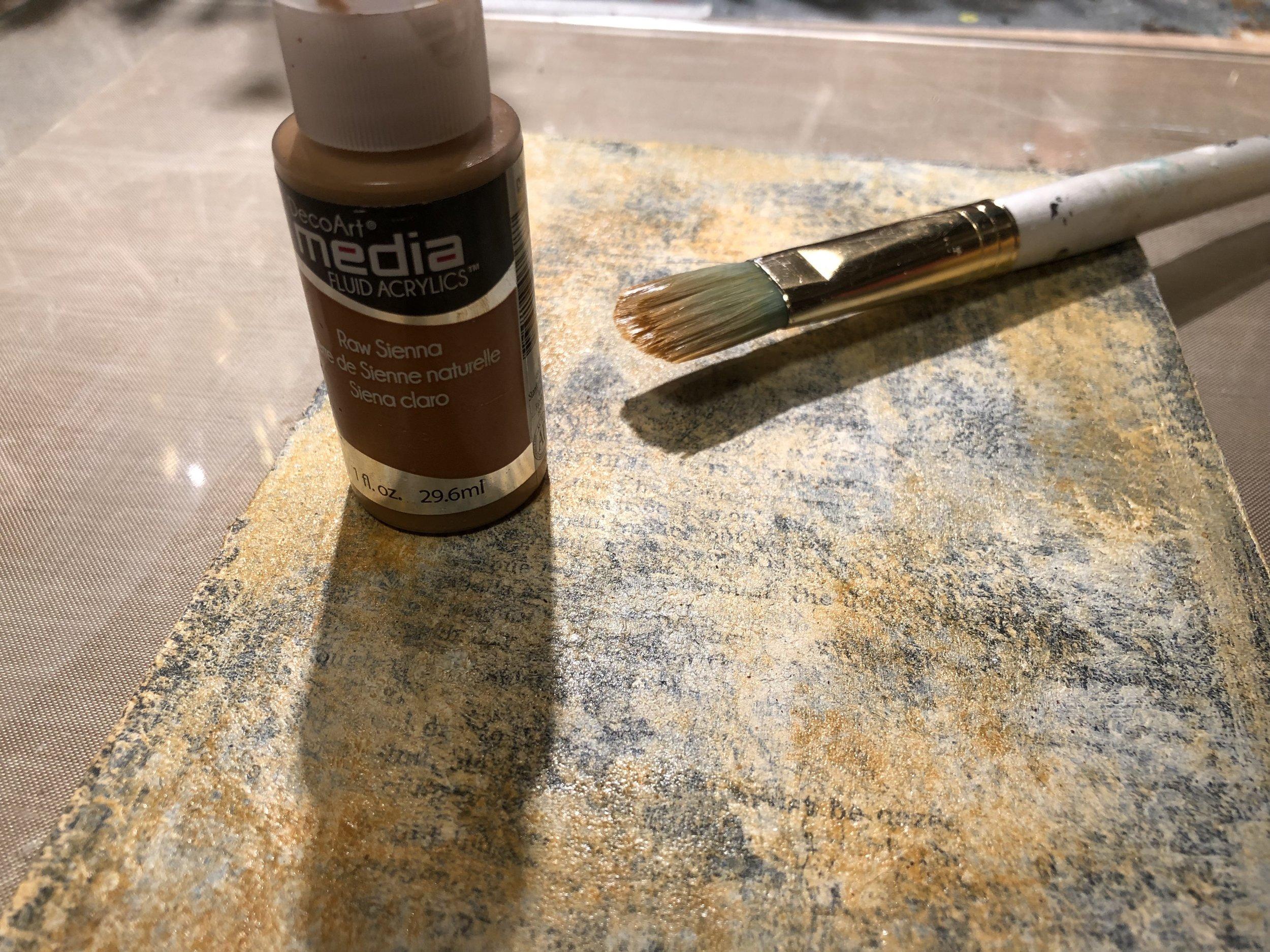 Brush a light layer of DecoArt Media Fluid Acrylic in Raw Sienna.