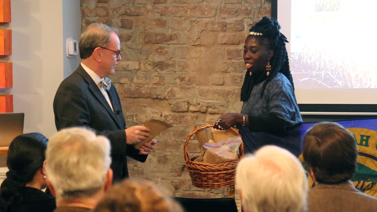 Dr. David Shields presents Queen Quet with seeds for repatriation