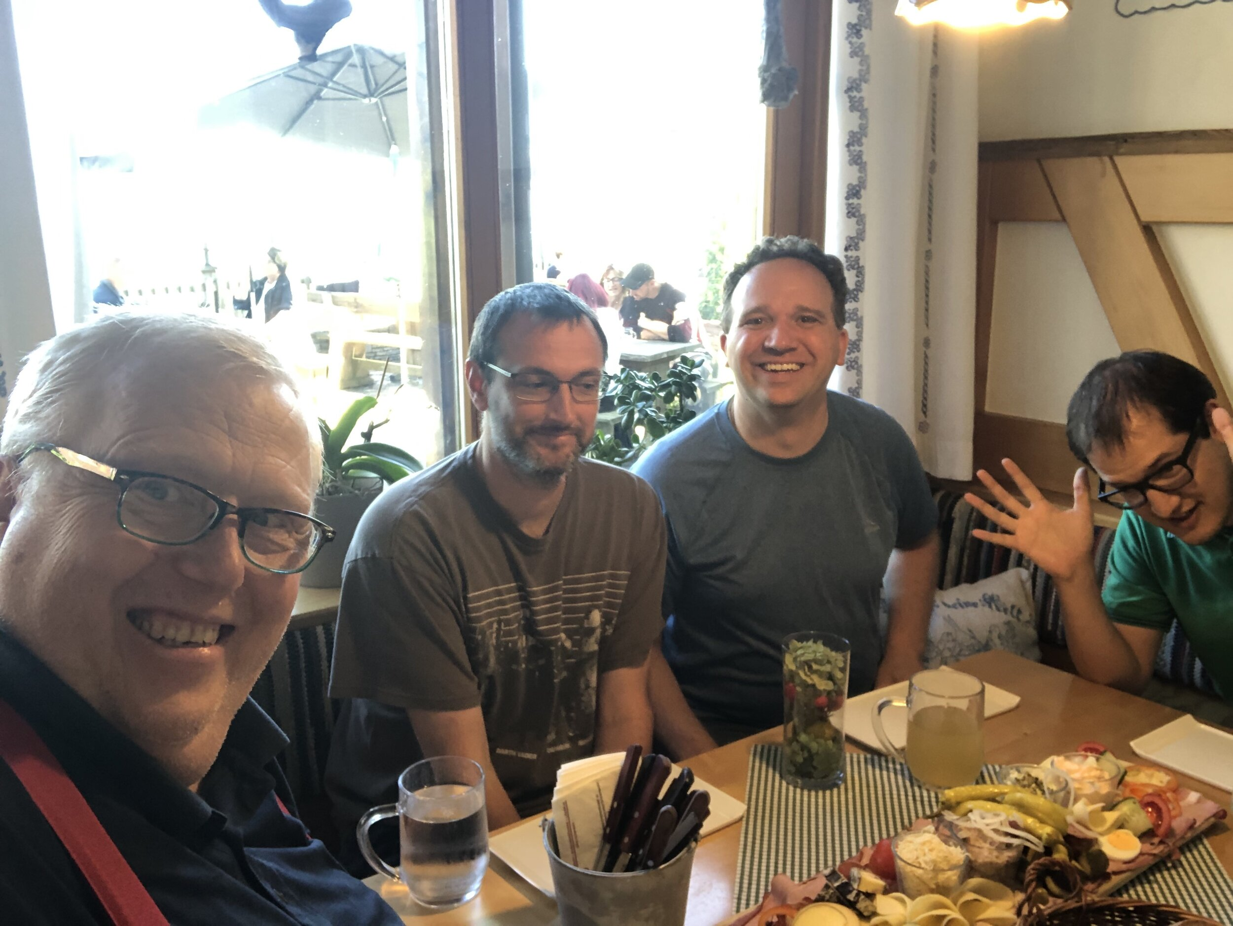 (L to R) Jeff, Stan, Andrew, and Ryan enjoying a delicious lunch in the hills above Graz