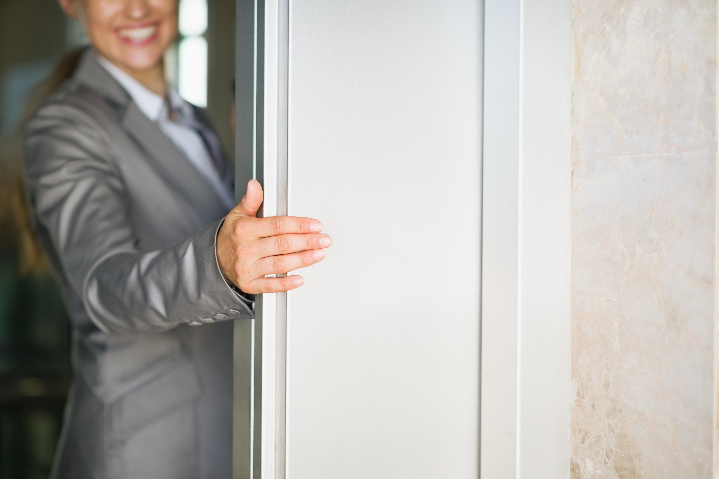closeup-on-business-woman-hand-holding-elevator-door-000045320296_XXXLarge.jpg