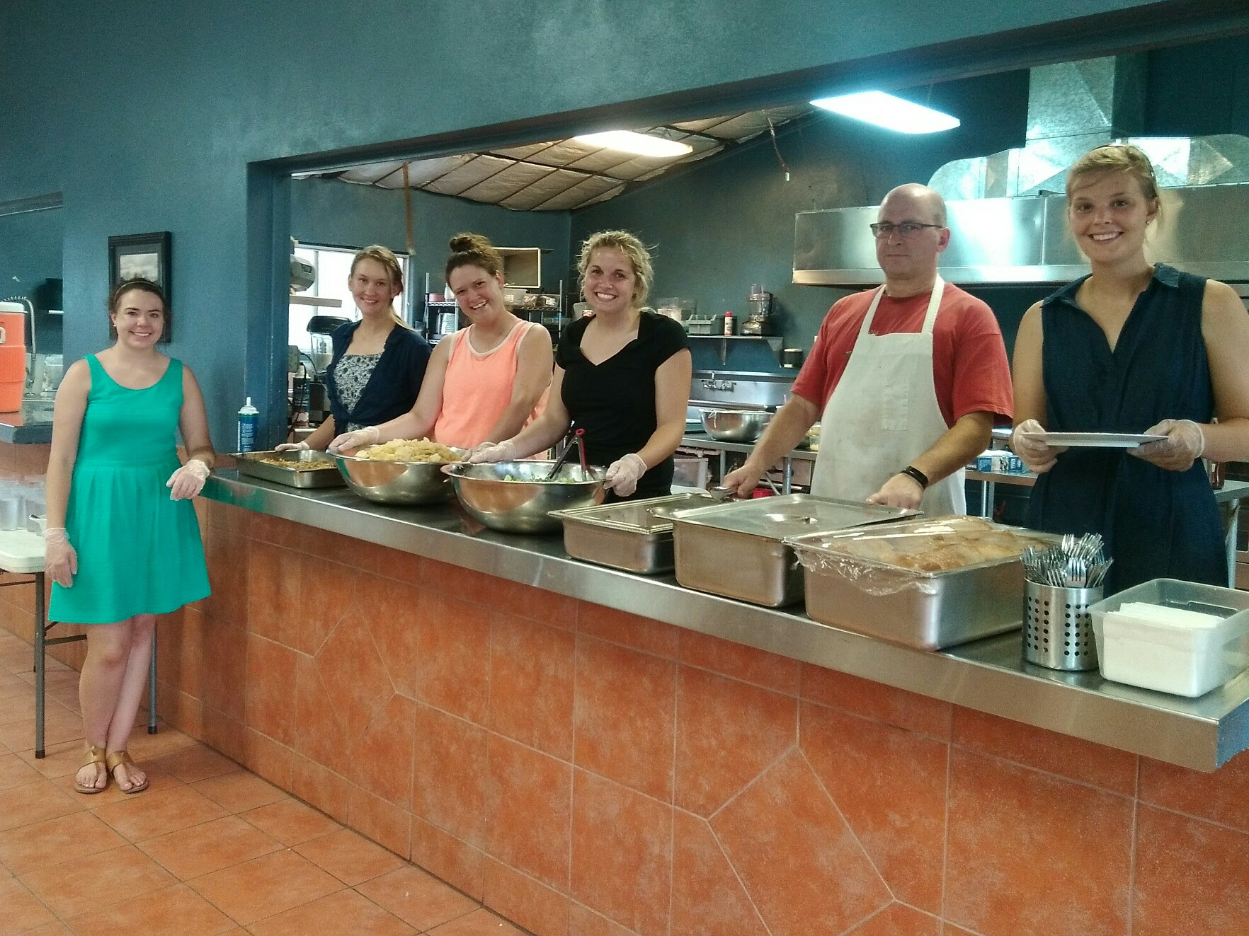 Preparing and serving supper at the orphanage.
