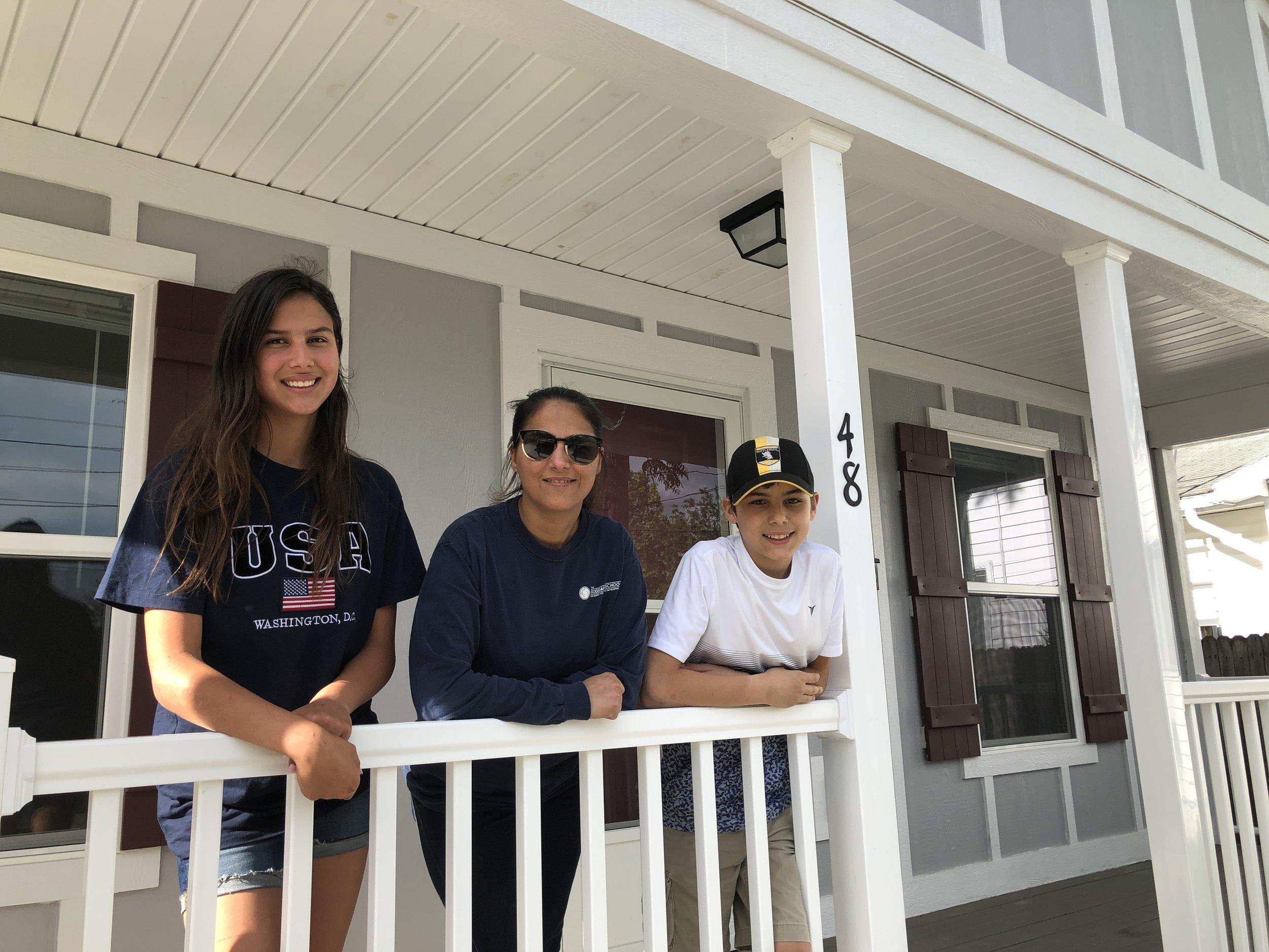 Future Habitat homeowner Zainab and her two children