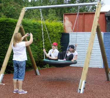 Smile please! The special swing is designed to carry 2-3   youngsters or can accommodate a carer on board