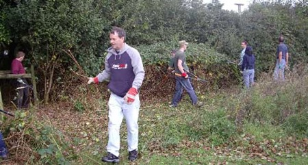 Fresh air and good company was enjoyed by the   volunteer group as they cleared some of the bramble   overgrowth at the perimeter of the Centre