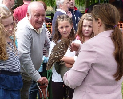 Ashley explaining the practical aspects of an owl's plumage to a captivate audience