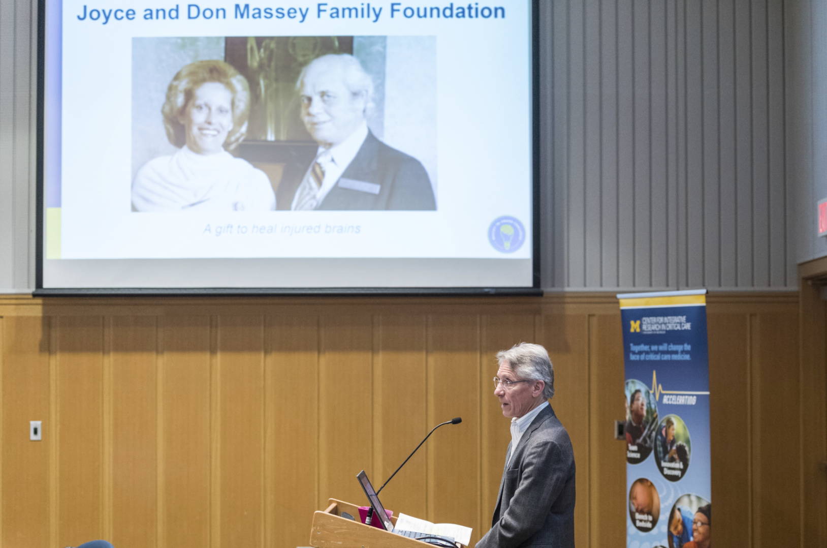 Dr. William Barsan presents the Massey TBI Grand Challenge mission, which is made possible thanks to a generous donation from the Massey family.