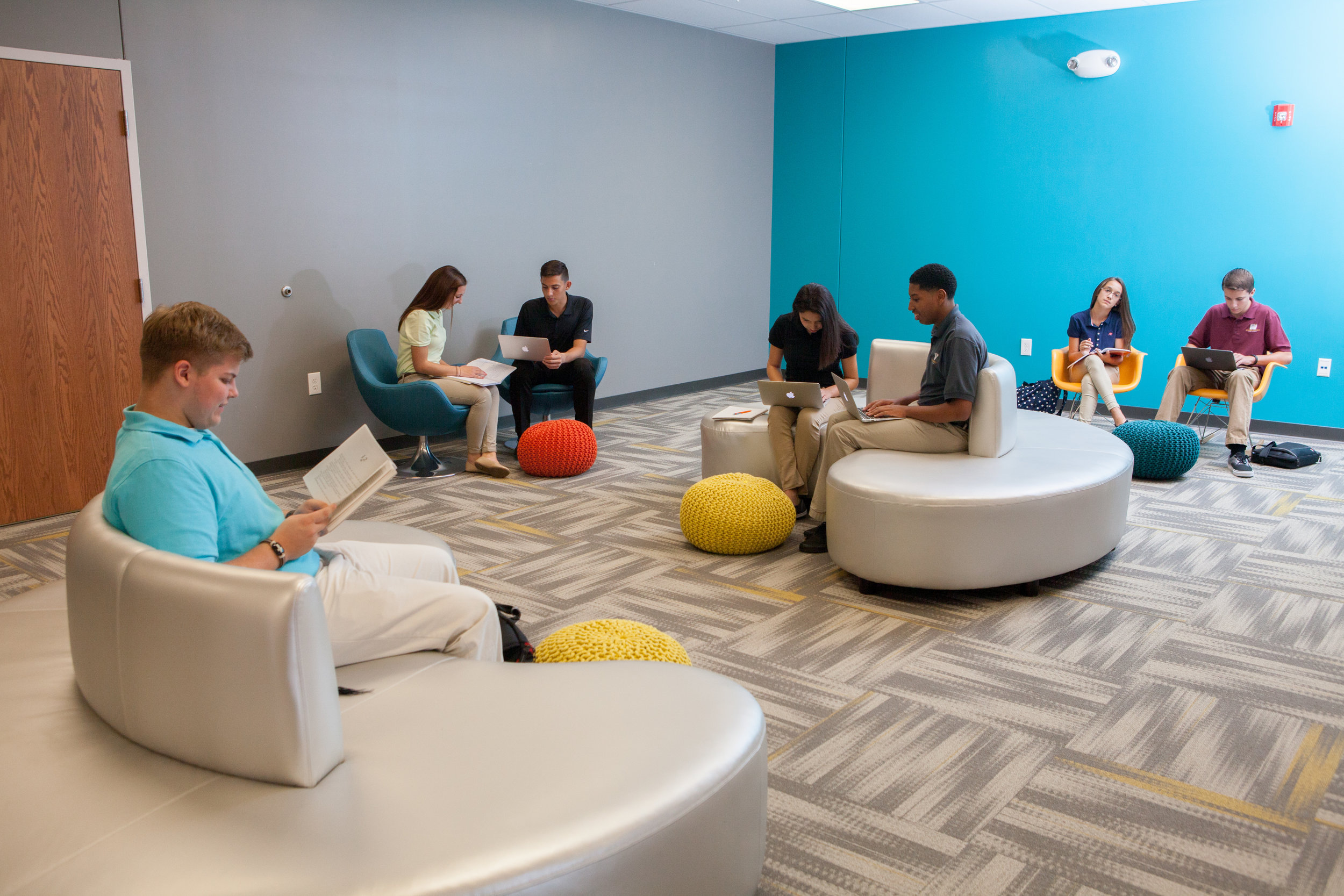 Pictured: Global Impact STEM Academy lounge area with students.