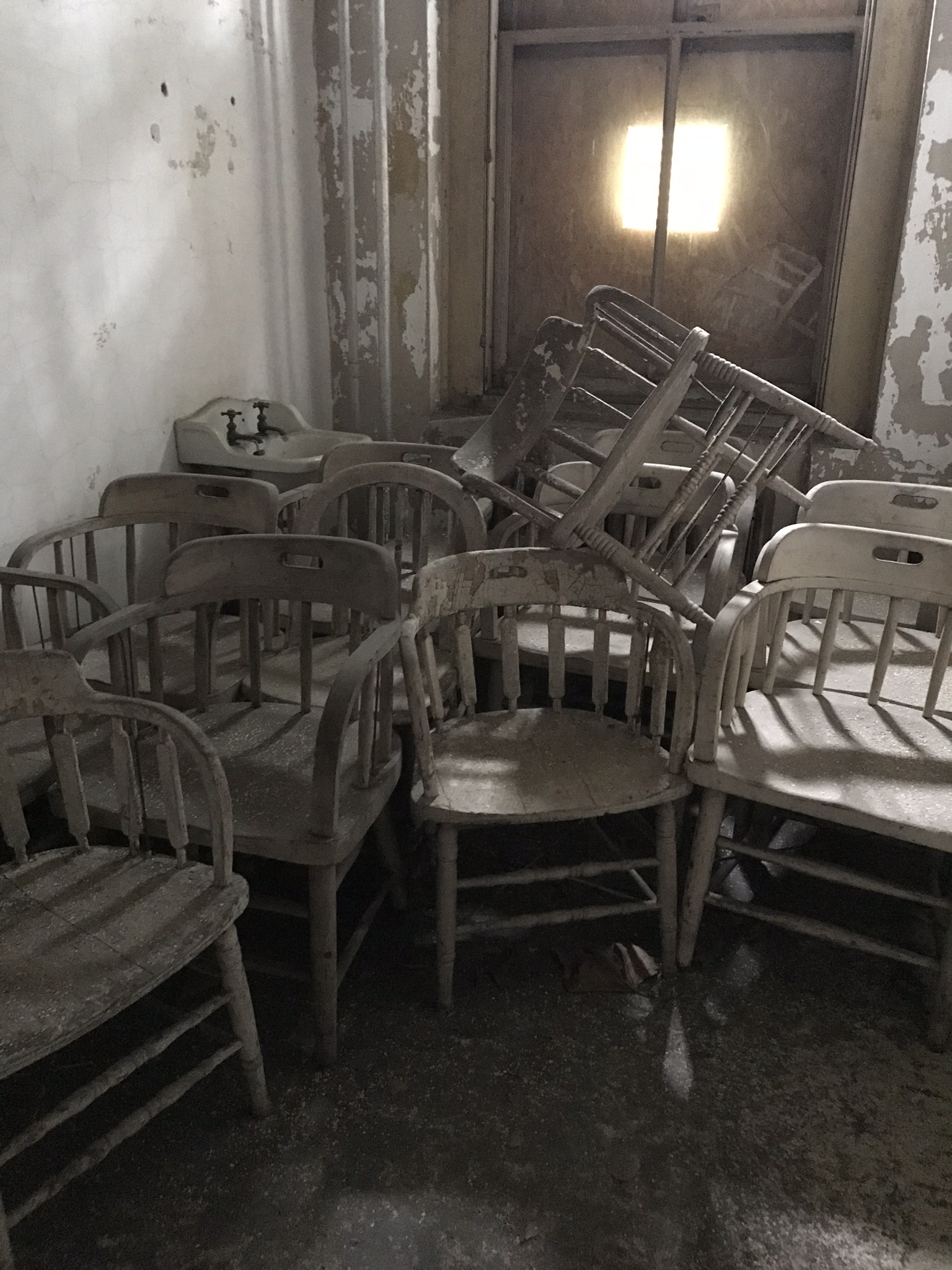 Old chairs stacked up.