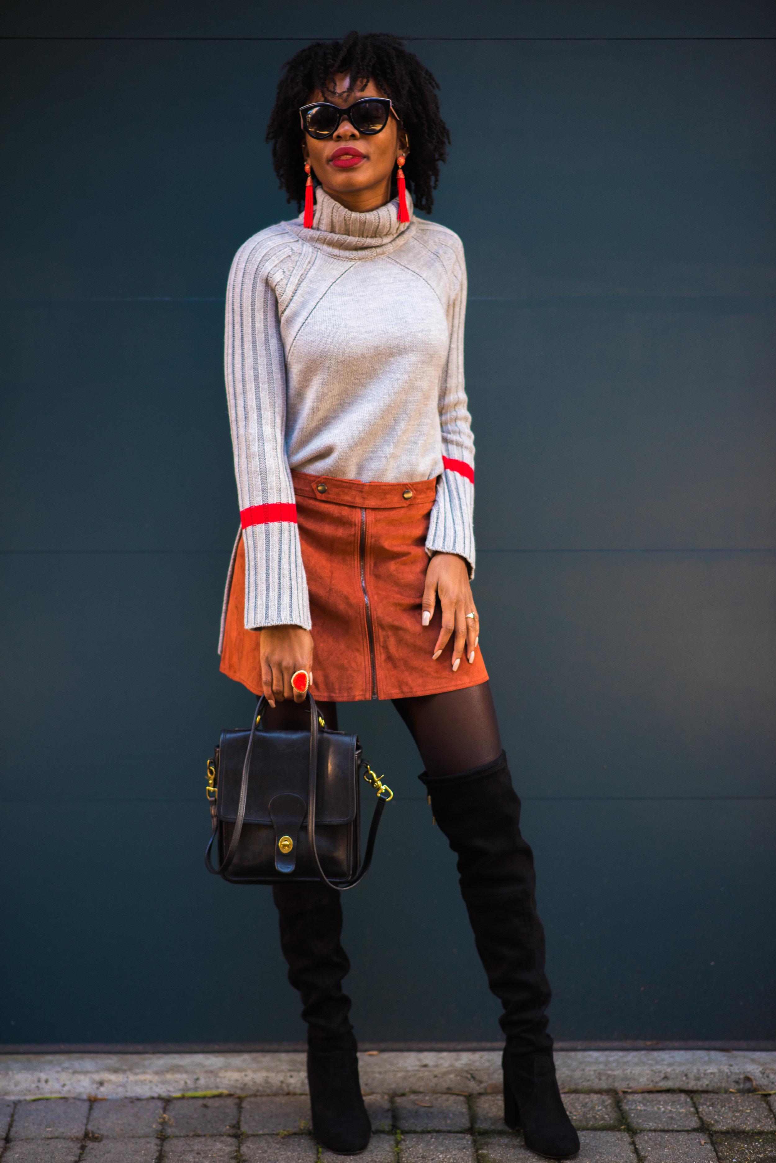 Sweater: Le Tote, Skirt: Forever 21, Boots: Steve Madden; Earrings: Le Tote; Sunglasses: Dolce & Gabbana