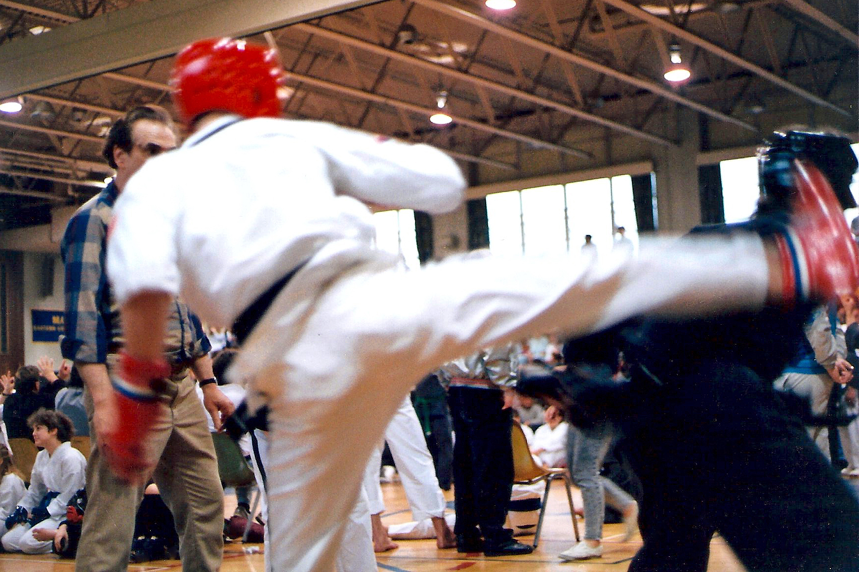 The header image for this story is not a stock photo, by the way. It was taken at the actual tournament in 1990. The person in the black uniform (who's not doing well in the photo) is one of the five black belts in the car with me in the story.