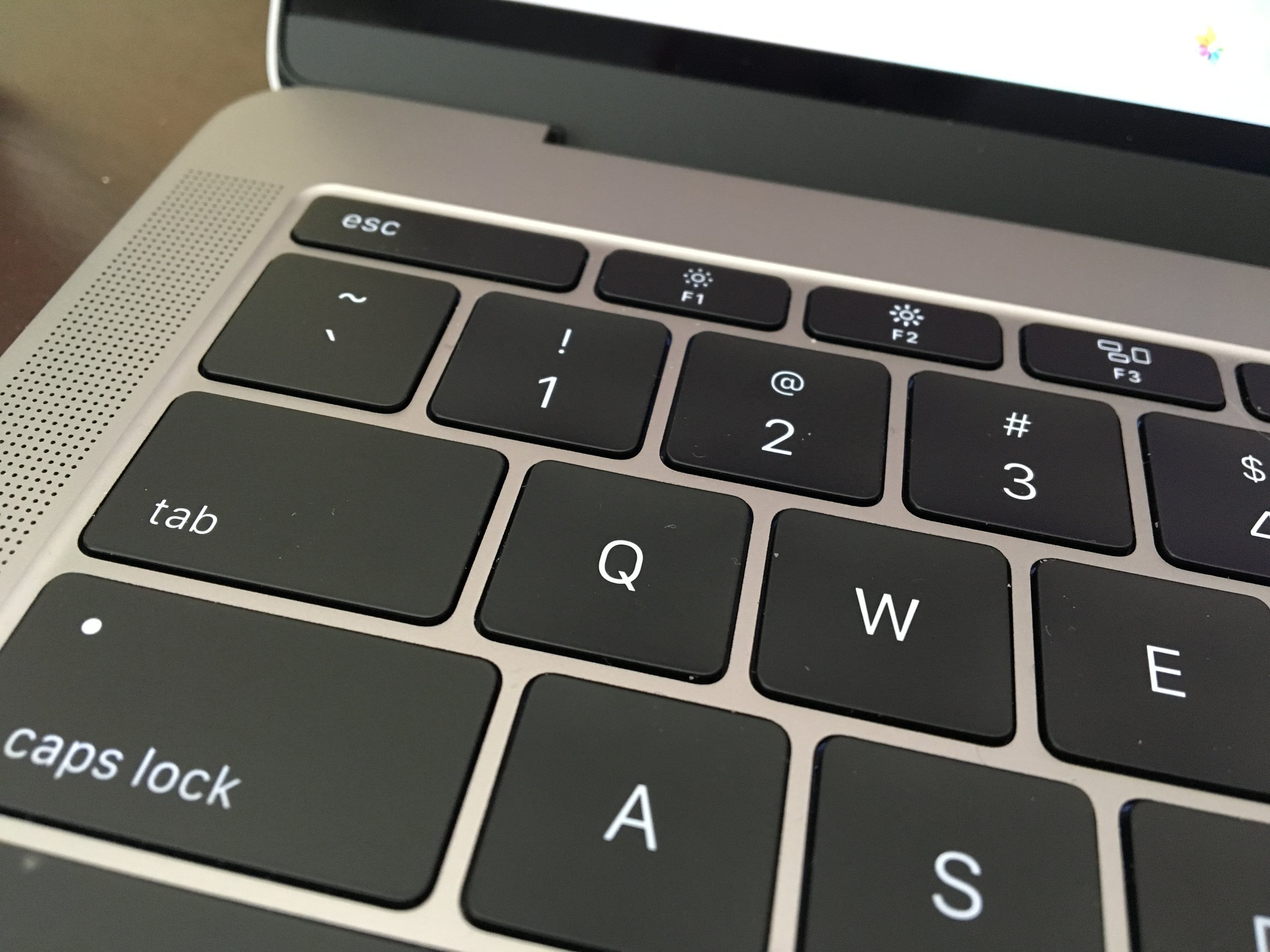 0.5 mm of travel. They keys are raised enough that you can find the right keys comfortably with touch typing, however.