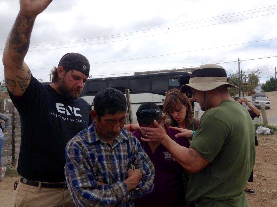James and Pastor Tom praying that God will restore this blind man's sight.