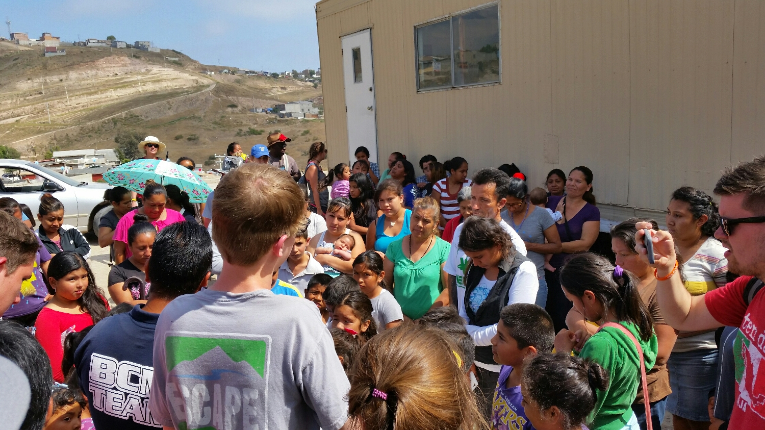 Caleb sharing the gospel message to a group of locals.