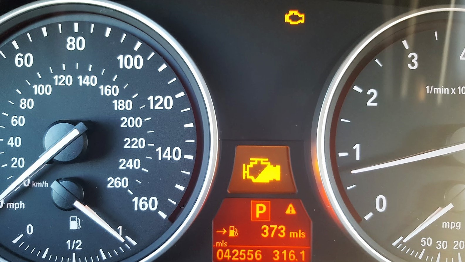 It is never a good sign when your car indicators light up and you have to check the owner's manual to see what the problem is! Here: engine malfunction; slowly proceed to the nearest service location. Um, great, just great!