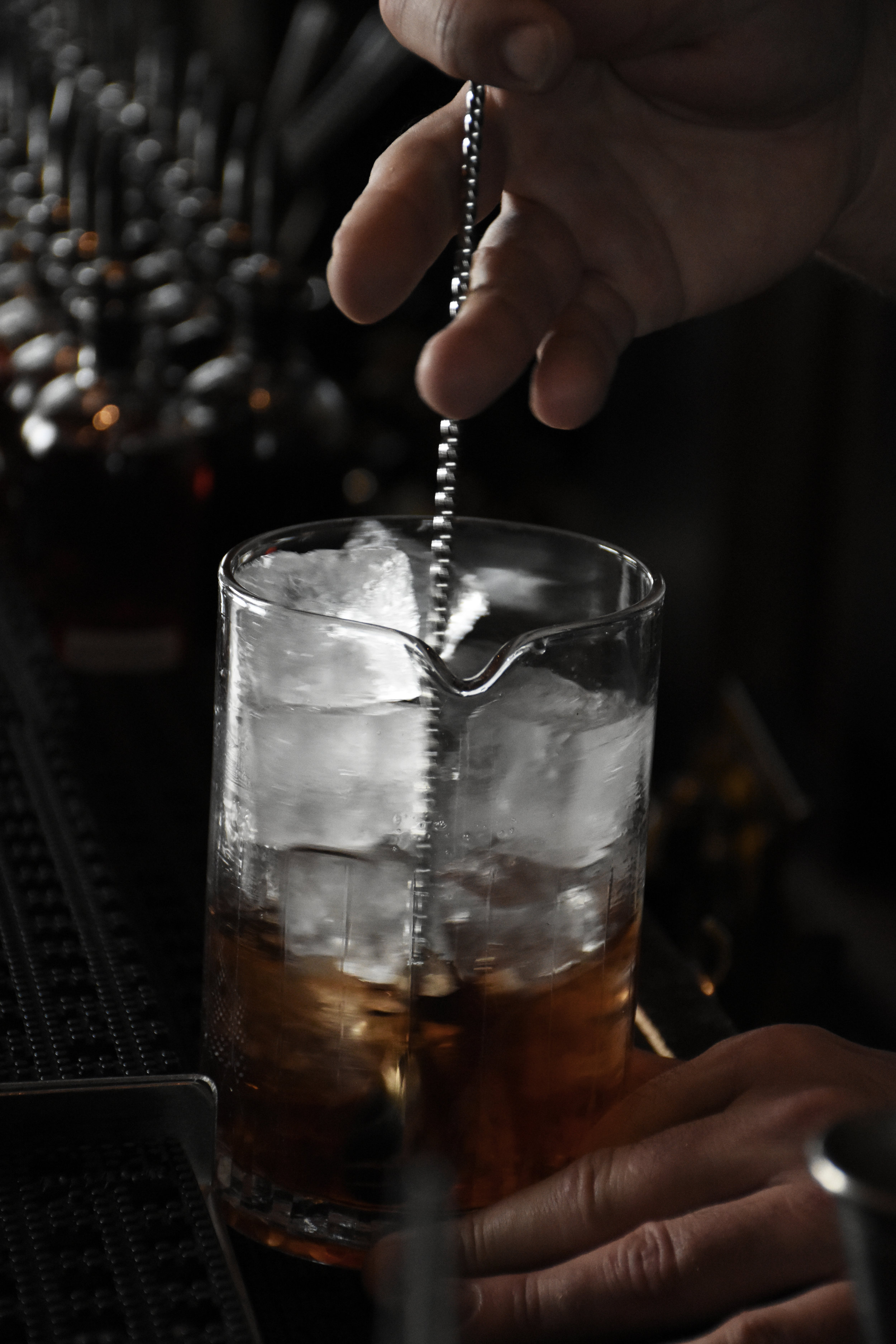 We begin with a Manhattan. Greg, always the professional, has his jiggering down to a pristine, well-practiced science.  -