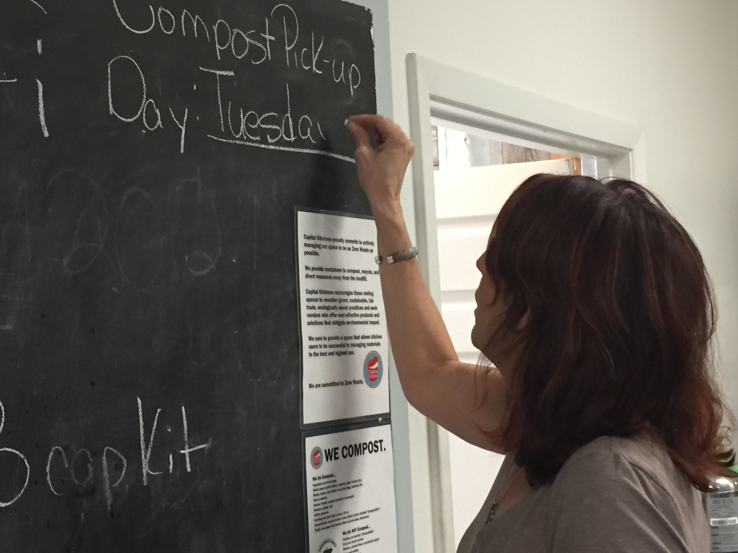 Capital Kitchens owner, Trish Wesevich, makes the site's new composting program official!