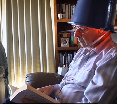 Watch  this video  about Max Burr, a retired Tasmanian federal politician who wears a bucket fitted out with LED lights on his head to keep his Parkinson's symptoms at bay