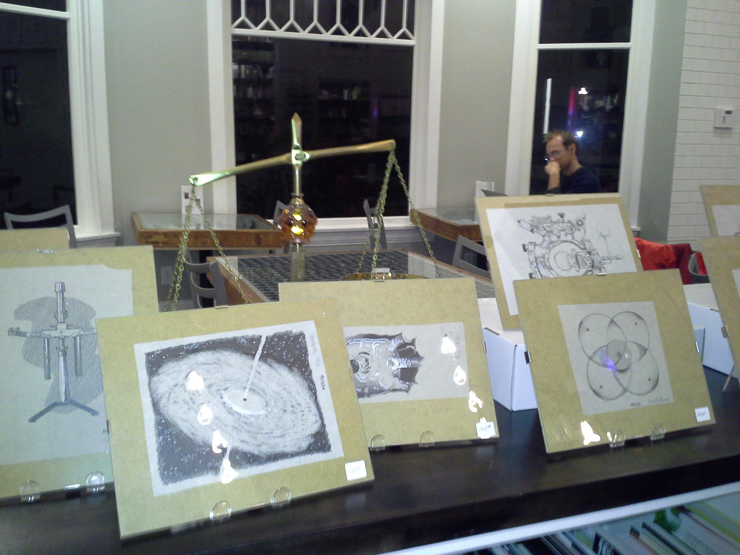 Matt Schmidt's artwork on display at Ada's Books.