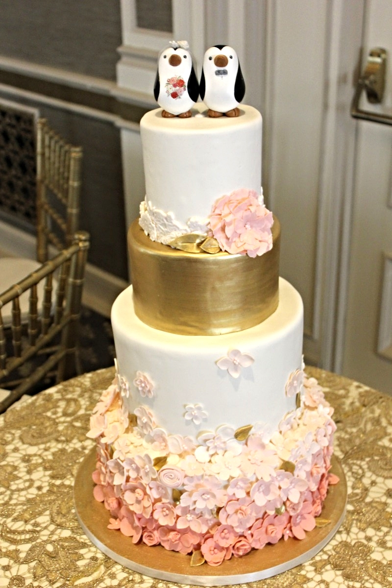 blush-ombre-flowers-with-gold-and-penguin-topper.jpg