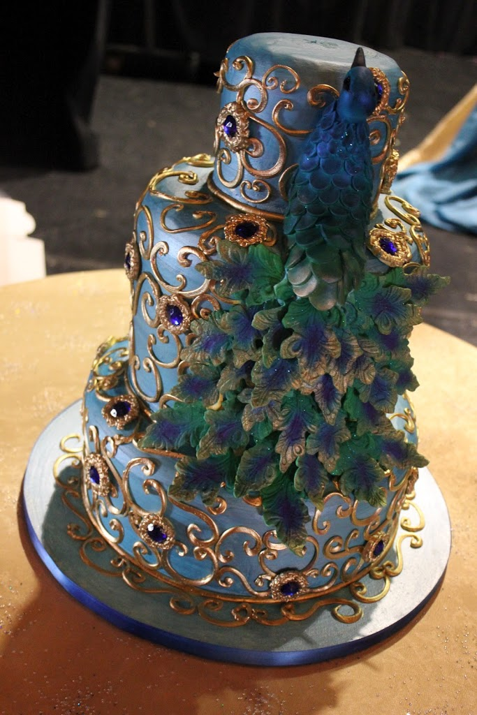 This sugar peacock cake was assembled from hand painted and hand cut sugar tail feathers.