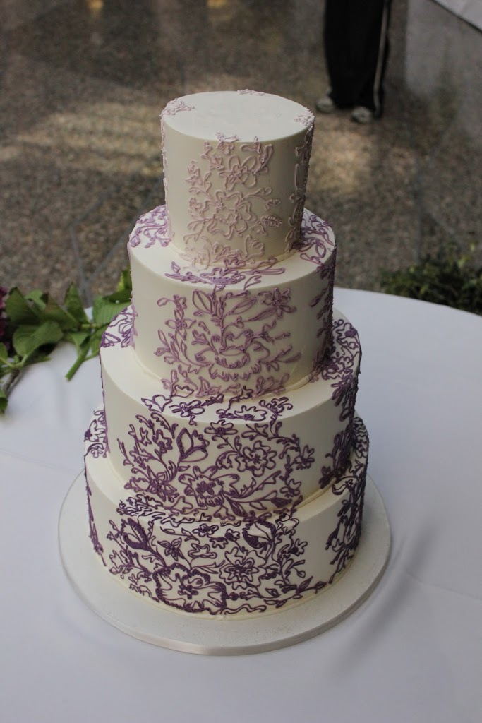 This cake was iced in buttercream with ombre piped buttercream lace inspired from the bride's dress.