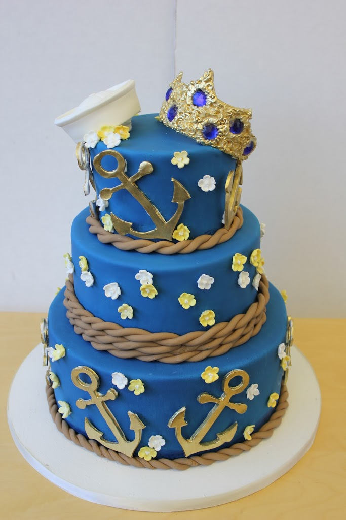 For darker colors like navy and black, I always use fondant since coloring buttercream this dark will turn everyone's mouth blue and black. Not cute for your wedding pictures!