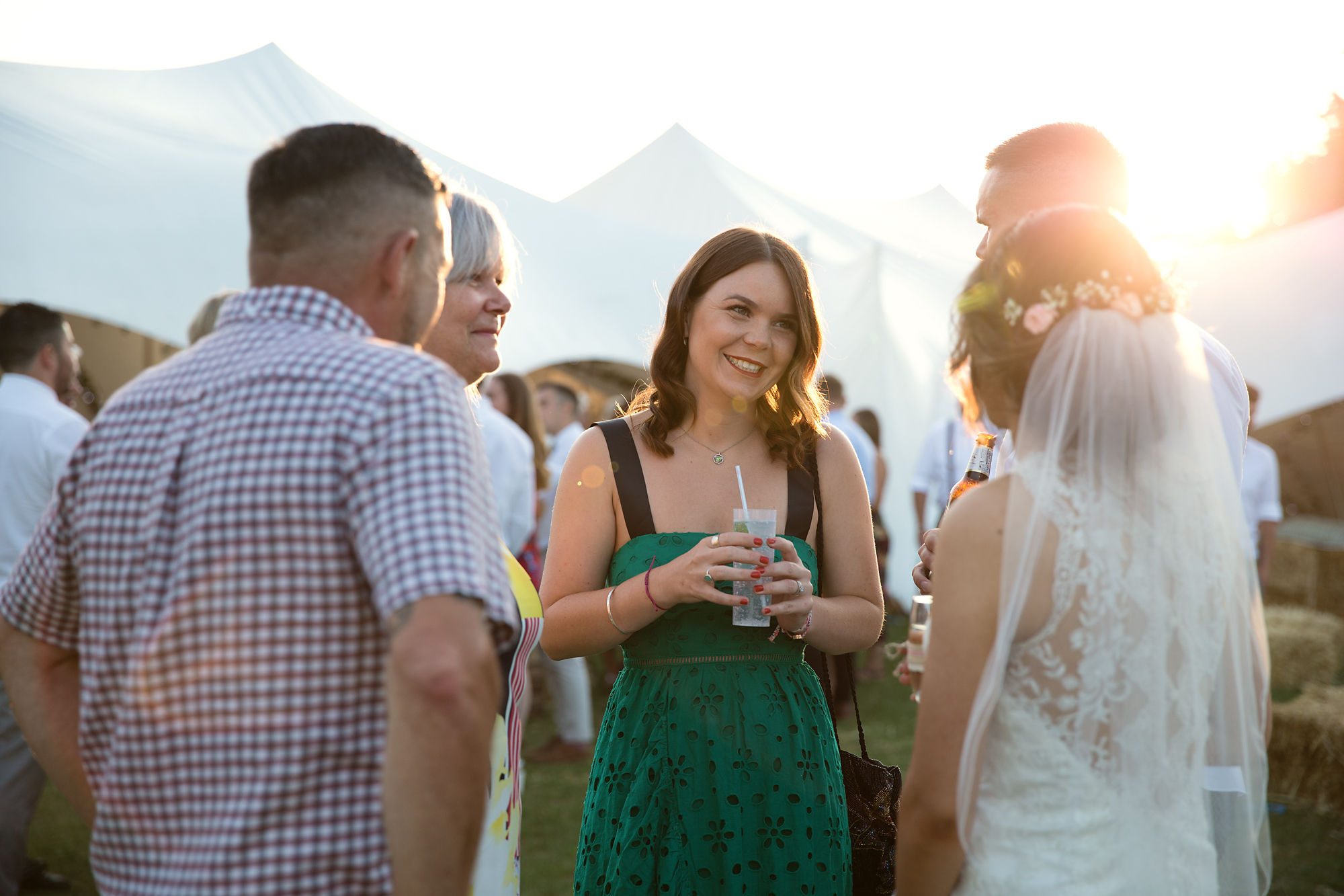 wedding guests at golden hour