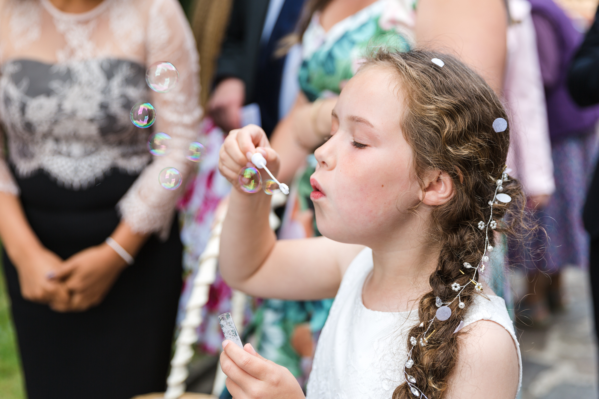 bridesmaid blowing bubbles outside St Martins Church, Caerphilly