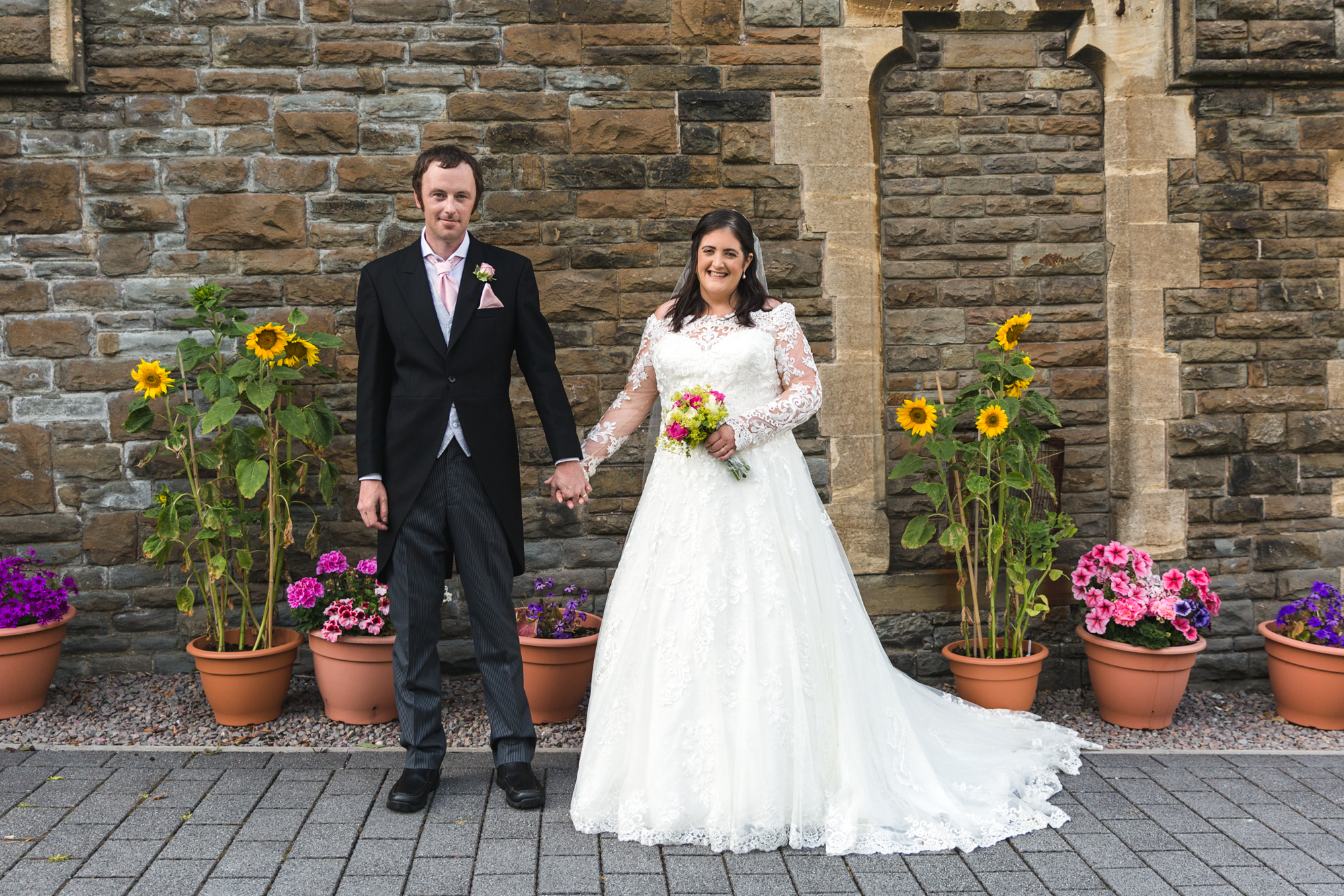 bride and groom portrait outside St Martins church, Caerphilly