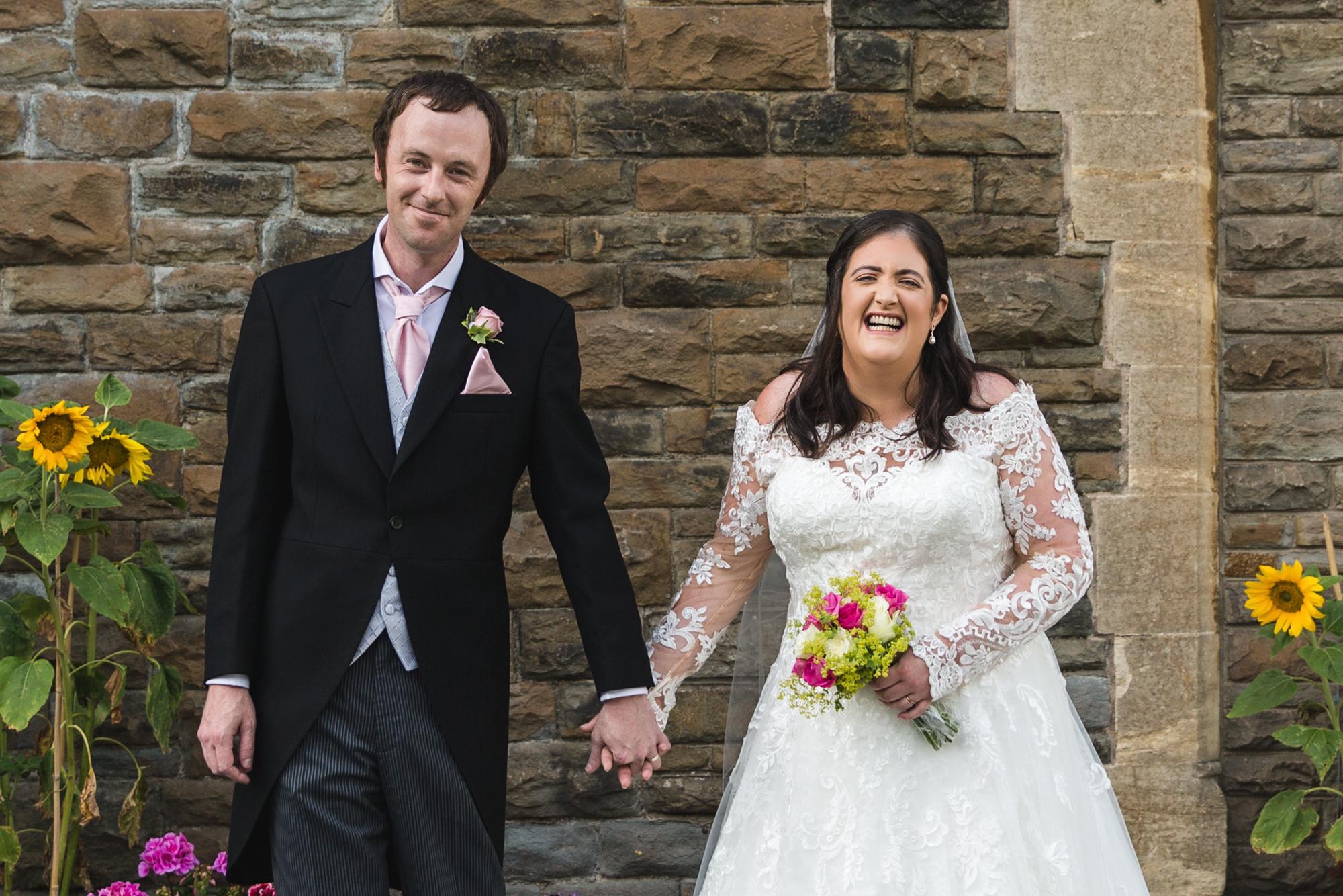 bride and groom natural wedding photo at St Martins Church, Caerphilly