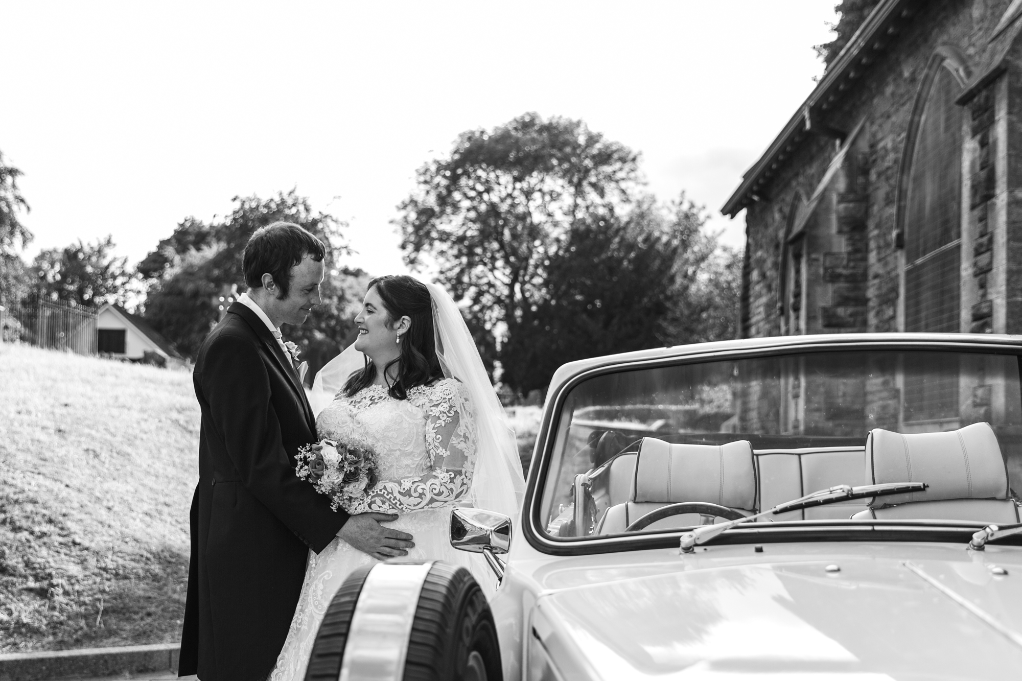 bride and groom with wedding car outside St Martins Church, Caerphilly