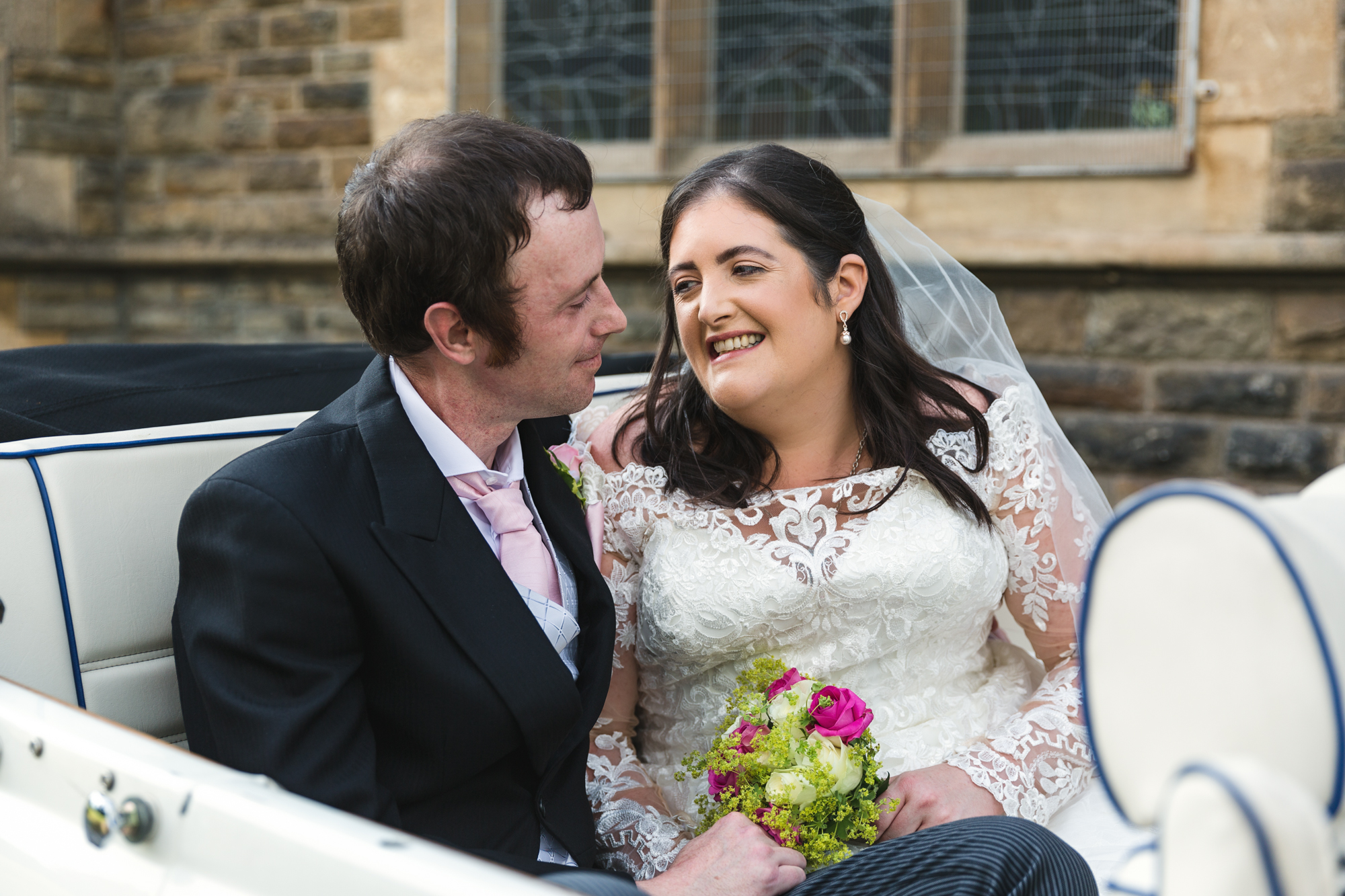 bride and groom photo in car outside St Martins Church, Caerphilly