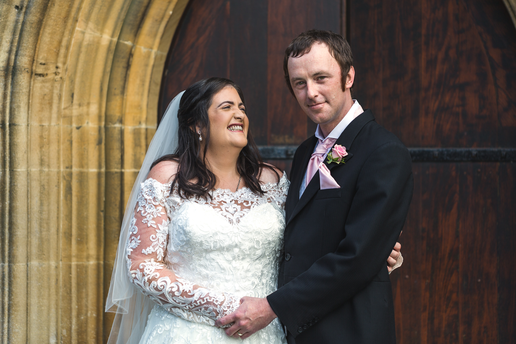bride and groom photos outside St Martins church, Caerphilly