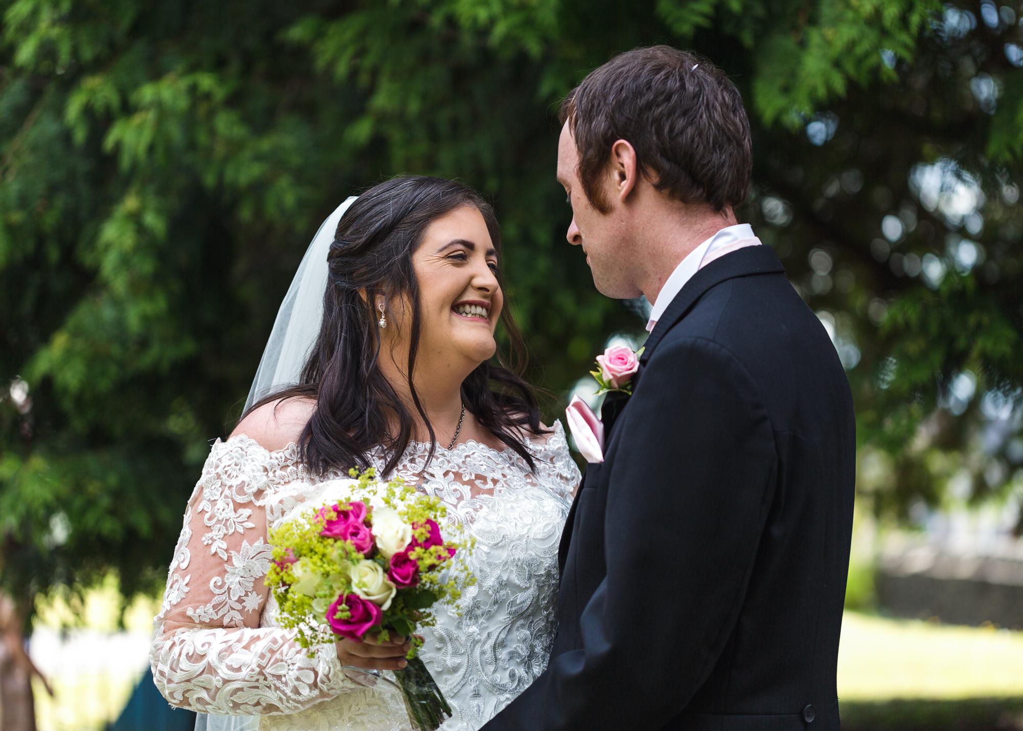 Bride and groom portrait St Martins Church Caerphilly