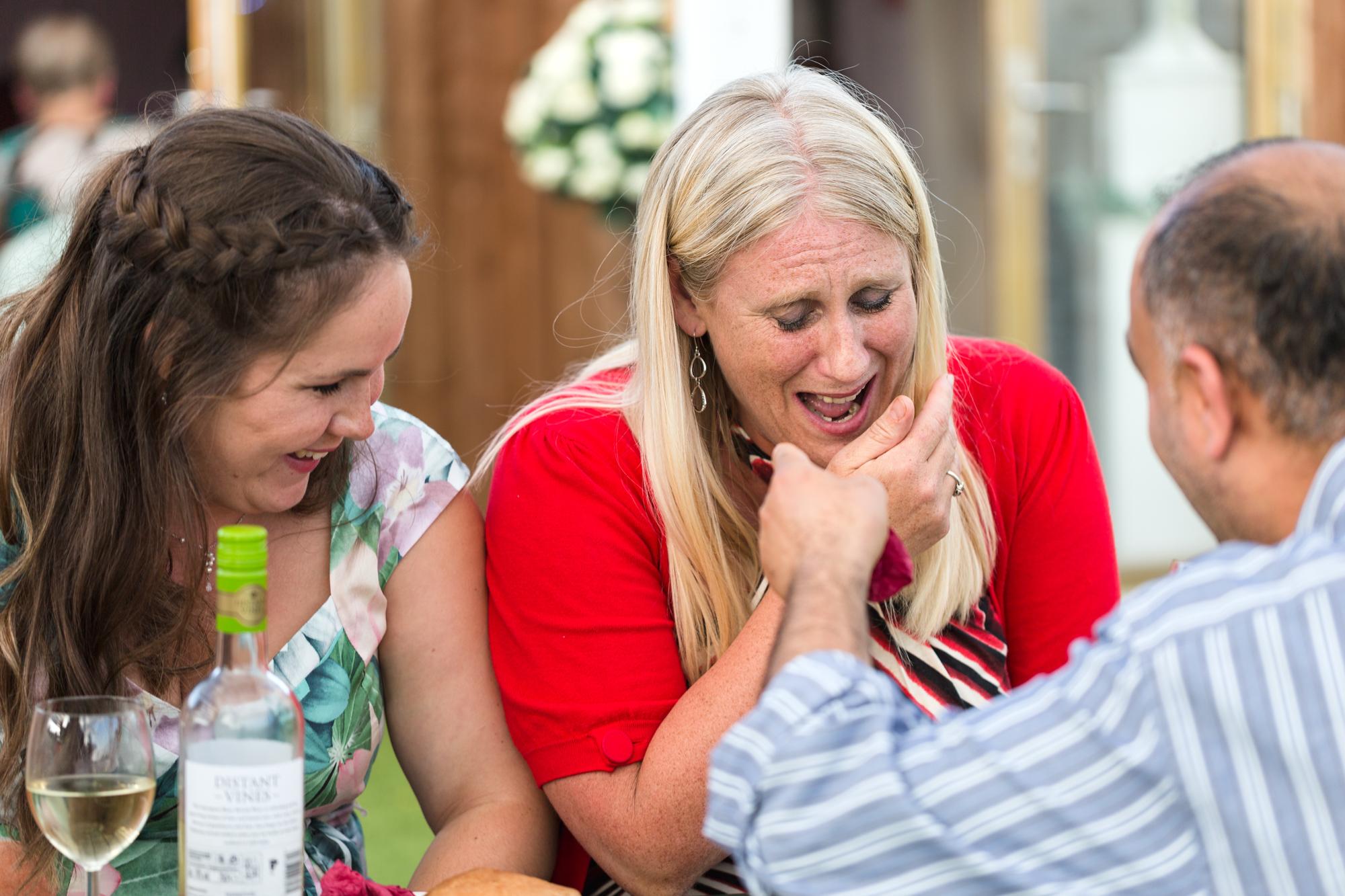 wedding guest laughing in Ridgeway golf club thornhill