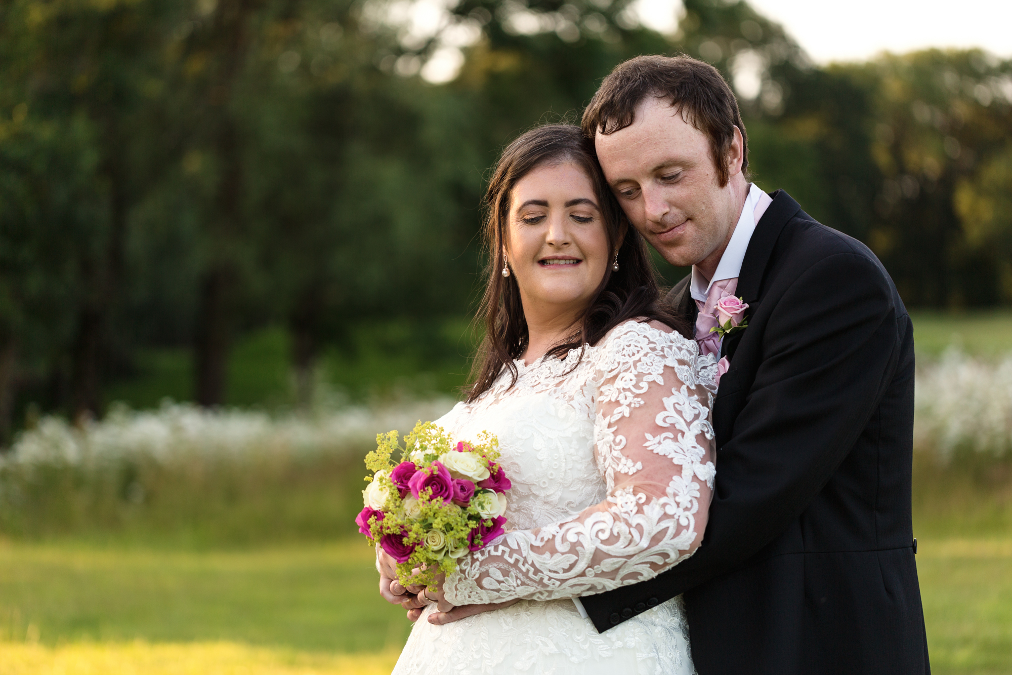 Bride and groom portraits in golden light at Ridgeway Golf club, Caerphilly mountain