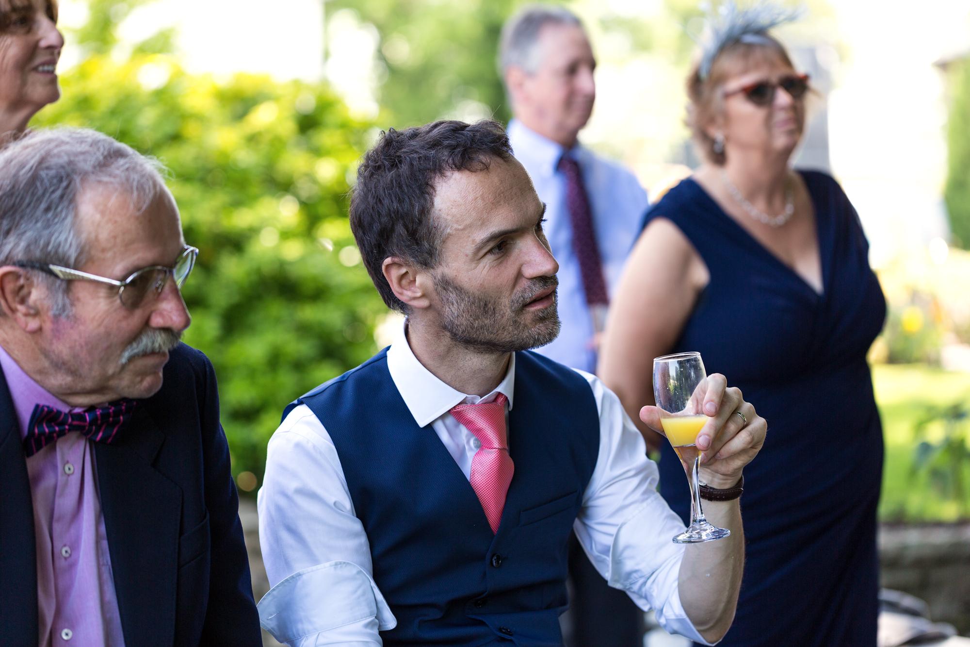 groom listening to Bargoed Male Voice choir at llechwen hall wedding reception