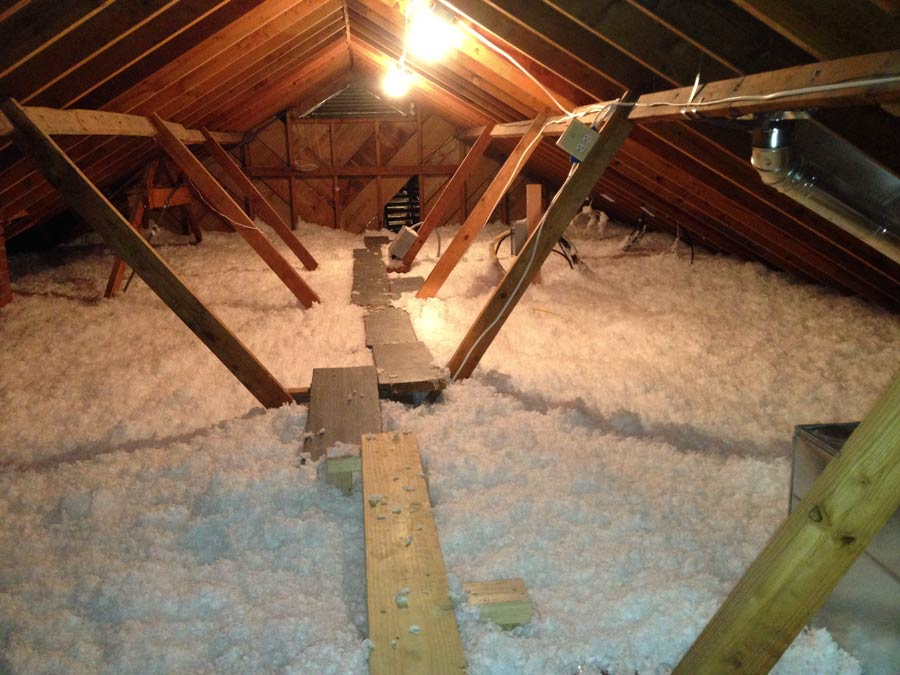 """About 16"""" of insulation were added - note the walkway created to access attic without compression of the insulation"""