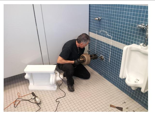 urinal_unclogged_handheld_snake_drain_medic.jpg