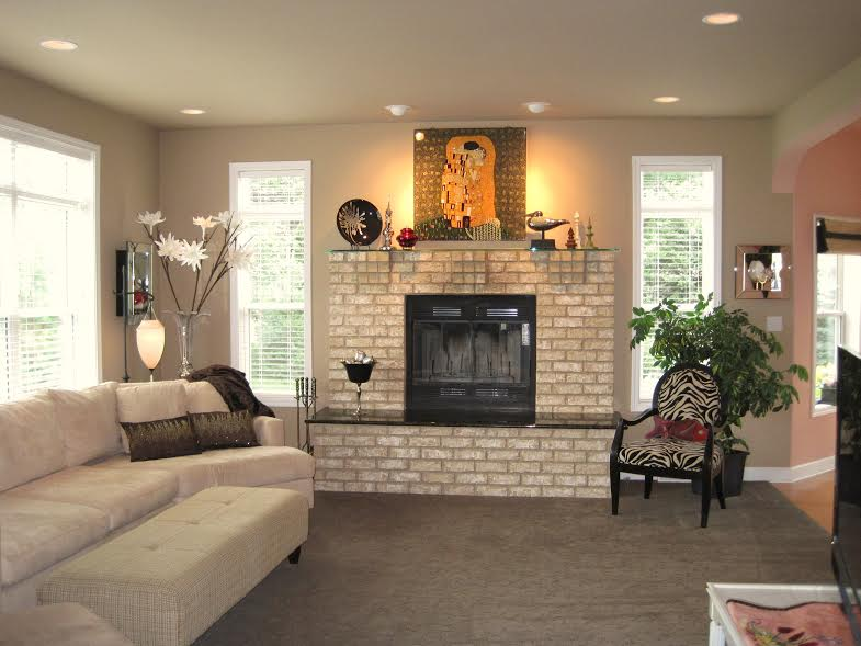Jennifer designed a stone natural fireplace with a granite hearth and clear glass mantle. Stunning.