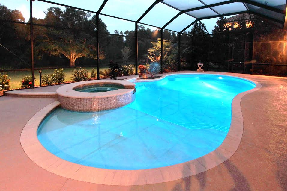 Jennifer designed this pool and spa with a sun shelf, fountain and Italian glass tile.