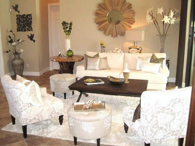 A white living room with green accents is very stylish.