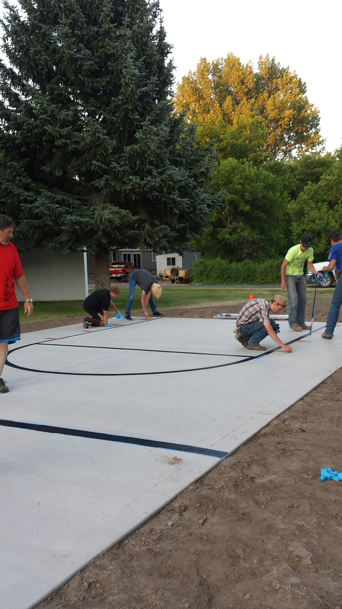 The Albion Scouts helped with nearly every step of the process and here they are adding the lines to the new court.