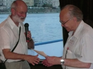 Two of our 'ISRA greats' — Professor John Archer (left) presenting Professor Murray Straus (right) with a life fellowship.