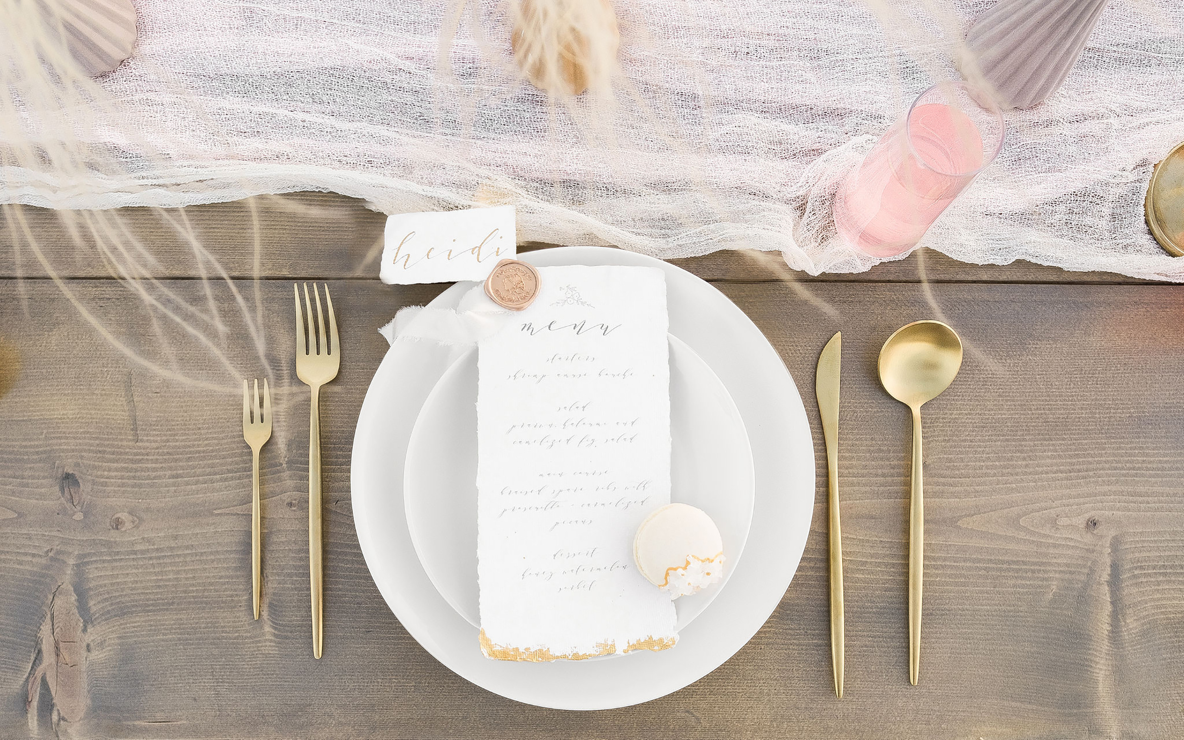 Table by  Bloomingbelles , macaron baked by Emy Ray Bakes, foliage by  Mylo Fleur , wax seal and ribbon by  Artisaire , paper by  Indian Cotton Paper Co. , Photography and stationery design by  Claire Falco Creative