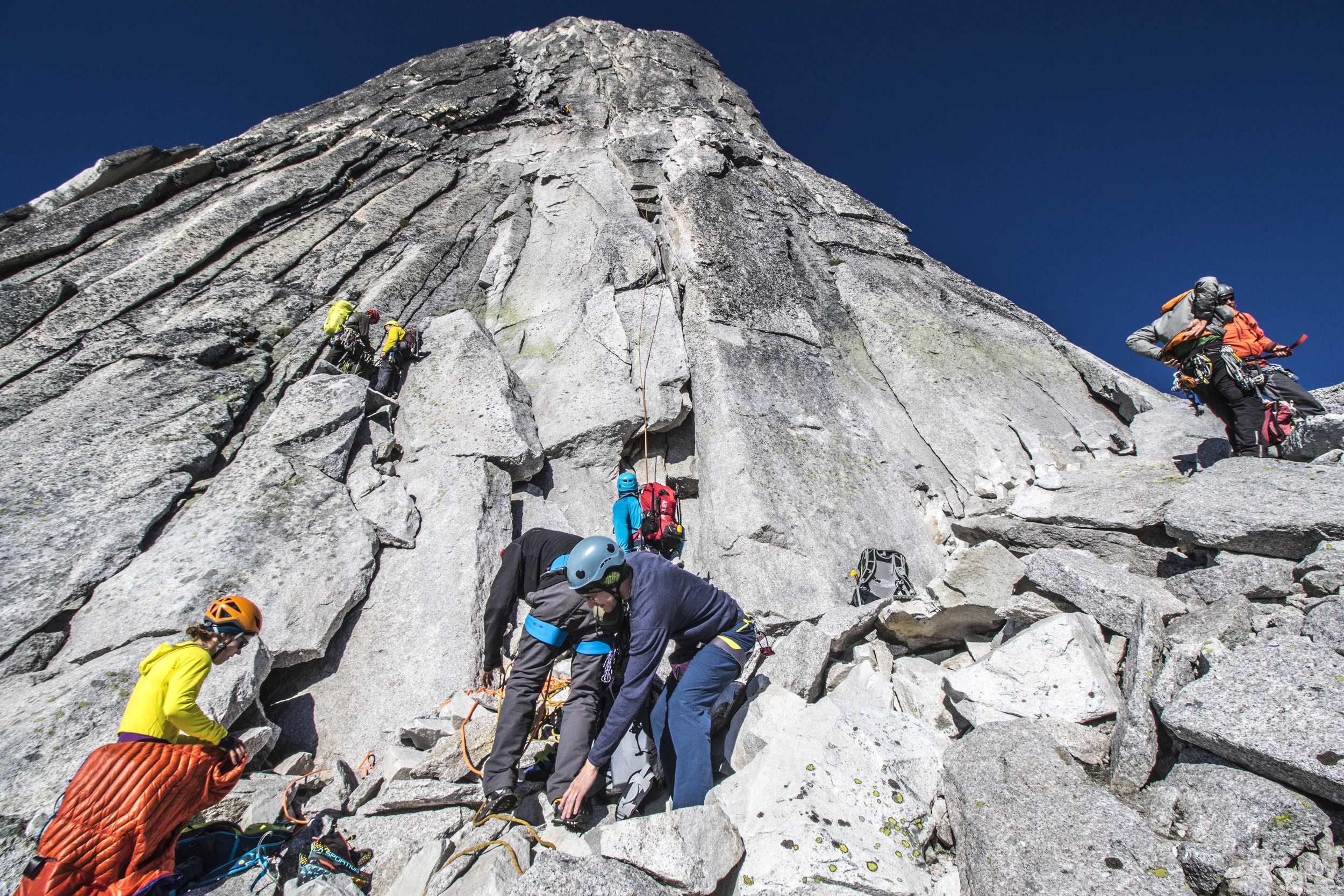 Climbers at the rope-up ledge on the Northeast Ridge of Bugaboo Spire. It's a party!