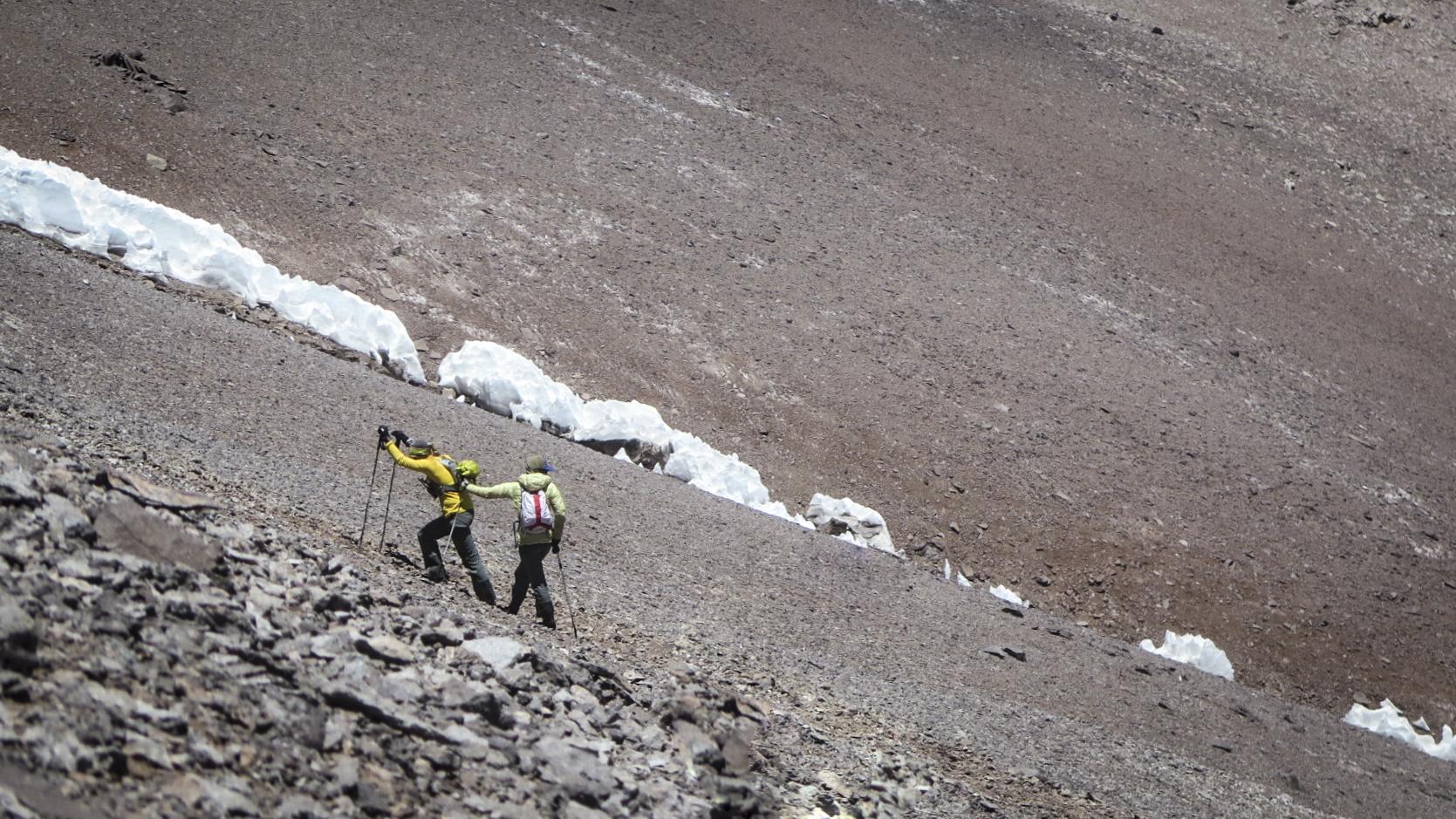 Teamwork on the mountain. Photo:  Julian Kusi