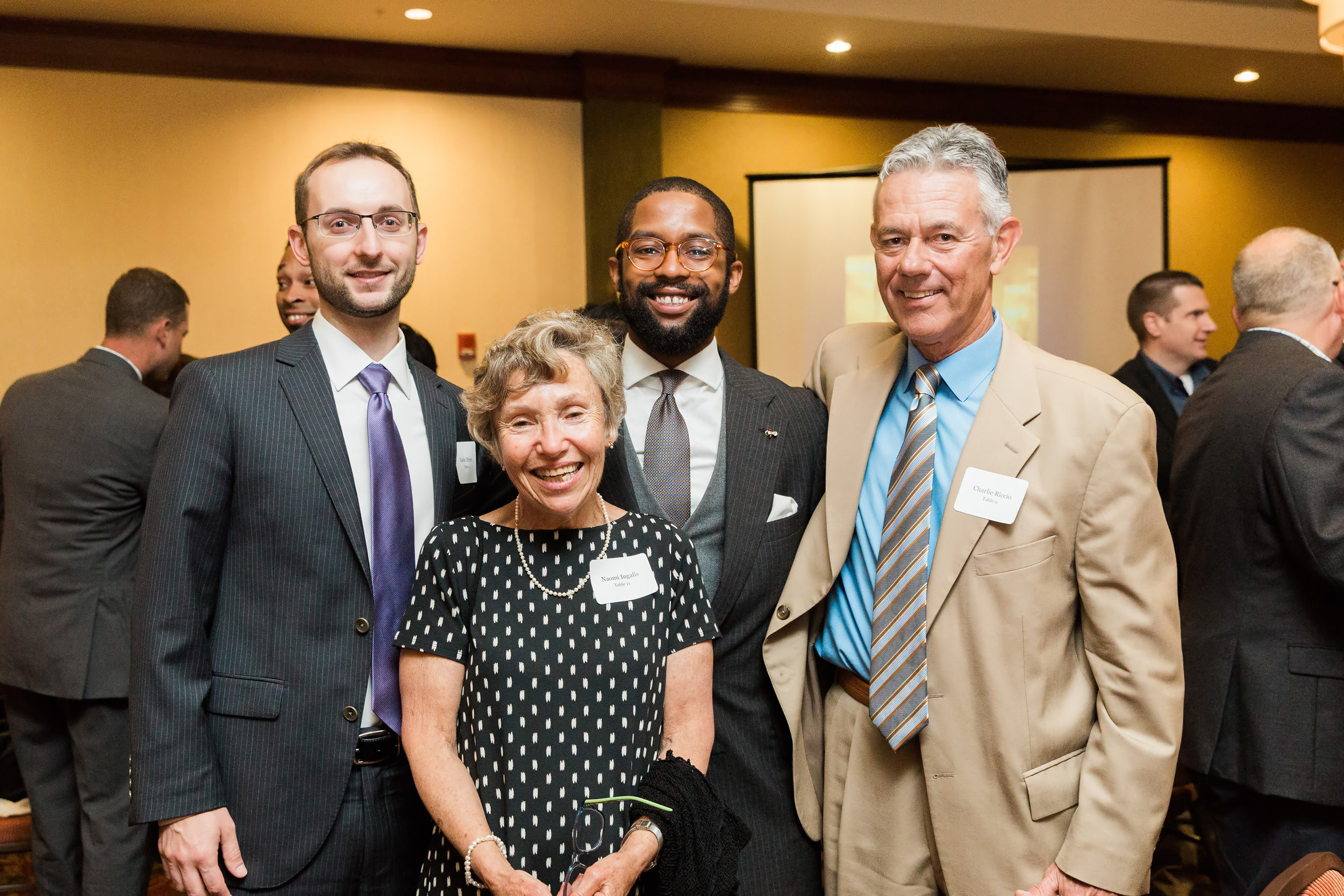 from left, Justin, Naomi Ingalls, former Troy mentor coordinator, Travon, and Charlie Riccio, former Troy Academic Coordinator