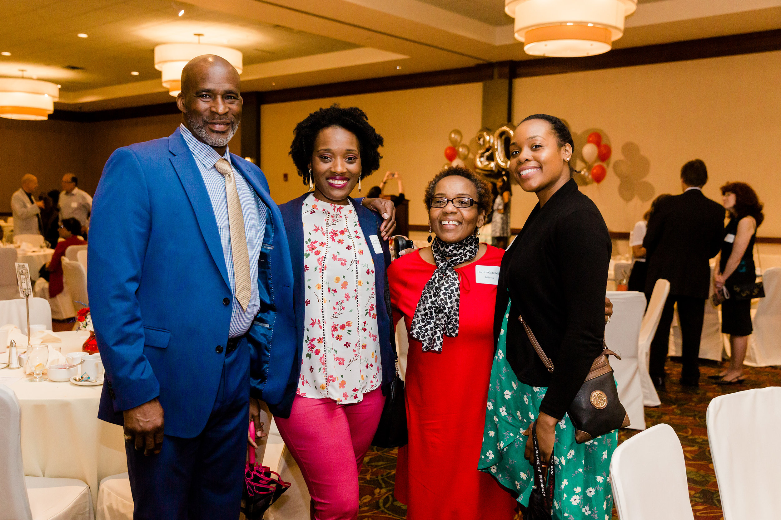 Alumni Board member Crystal Campbell and her guests