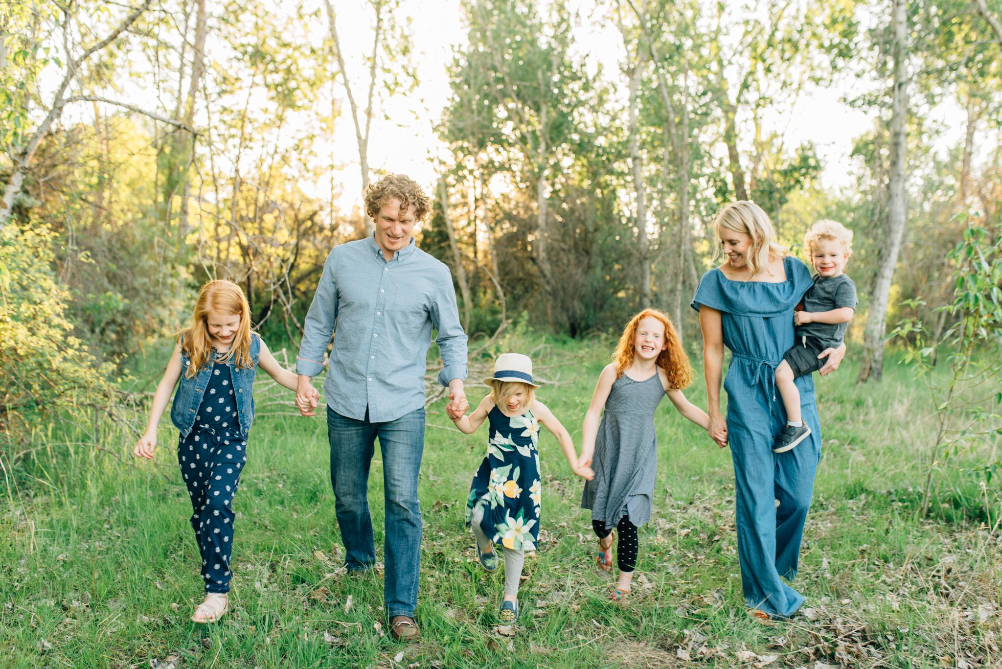 boise family lifestyle session| barber park | boise family photographer | family walking and smiling
